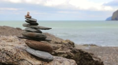 Balancing meditation rocks with sea in the background  Stock Footage