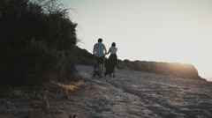 family walking with stroller - stock footage