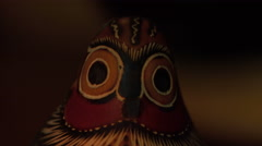 Creepy wooden owl figurine flickering under candlelight Stock Footage
