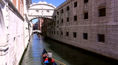 Gondola floating on a narrow canal in Venice Stock Footage