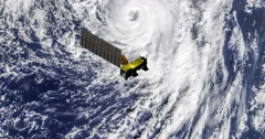 Top view of Earth-observing Aqua spacecraft in orbit above Hurricane Alex. Stock Footage