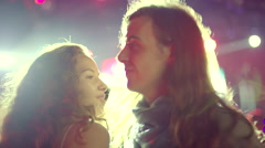 Blonde girl and long-haired guy couple  dance at concert Stock Footage