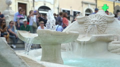 Old marble fountain that pours water in piazza di Spagna Stock Footage