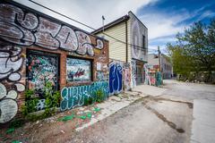 Graffiti in an alley in the Kensington Market neighborhood of Toronto, Ontari Stock Photos