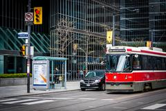 Streetcar and modern buildings at the intersection of Simcoe Street and King  Stock Photos
