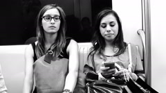 Black-and-white women sitted in metro wagon - stock footage