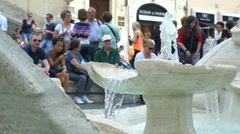 Fountain that pours water into Piazza di Spagna in Rome Stock Footage