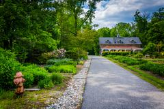 House and gardens along a path at Cylburn Arboretum, in Baltimore, Maryland. Stock Photos
