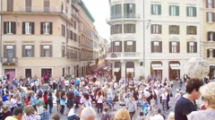 Piazza di Spagna with crowds of people walking Stock Footage