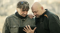 Two man in matera watching tablet Stock Footage