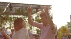 Close up of couple dancing at a concert  at sunset Stock Footage