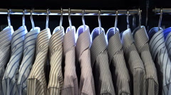 Man shirts on shop hangers display abstract dress for job hunting Stock Footage