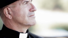 Priest scans the horizon - stock footage