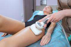Correction cellulite figures in the beauty salon - stock photo