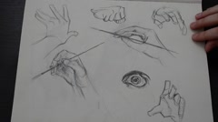 We thumb through sketchbook with drawings. Stock Footage