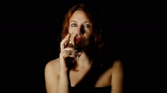 Woman drink red wine sensually Stock Footage