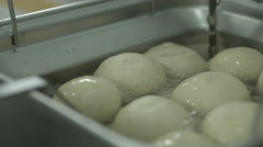 Placing Donuts in fryer Stock Footage