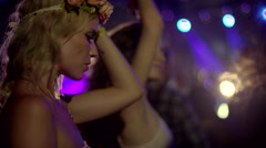 Blonde girls dancing at concert Stock Footage