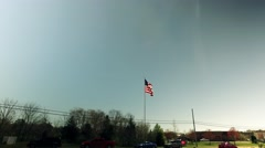 The Flag Flying Above Traffic and Real Life Stock Footage