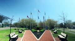 Veterans Memorial with Military Flags Flying High Stock Footage