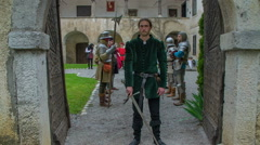 Bowing when an important guest enters into a castle - stock footage