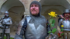 Knight with a yellow rose - stock footage