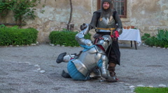 Helping another knight to stand up - stock footage