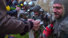 Visitors are putting white ribbons on the knights' swords Stock Footage