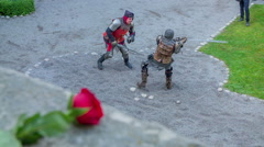 Red rose is lying on the castle's wall Stock Footage
