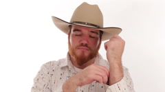 Hipster millennial cowboy with an ace up his sleeve with a smug look Stock Footage