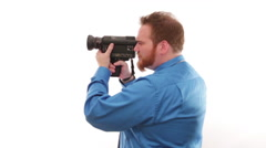 Hipster millennial businessman turning with a vintage 8mm camera Stock Footage