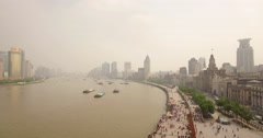 Shanghai Bund pull back aerial Stock Footage