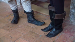 Black medieval boots Stock Footage