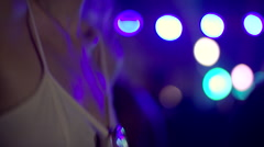 Blonde girl dancing at concert Stock Footage