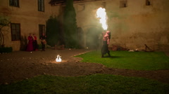 Fire-eater and a fire is burning on the ground Stock Footage