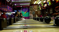 People playing bowling game at the West Coast Amusements Carnival - stock footage