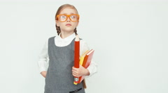 Young teacher on white background with glasses threatens finger Stock Footage
