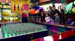 People playing ring gold bottle carnival game in Coquitlam BC Canada. - stock footage