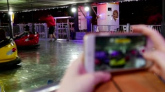 Recording people playing bumper car on iphone Stock Footage