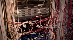 small messy server room in school building lots of cables tangled chaos - stock footage