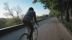 Young hipster man riding gixed gear bike on the road  Stock Footage
