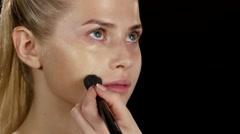 Makeup. Applying foundation. Black. Closeup Stock Footage