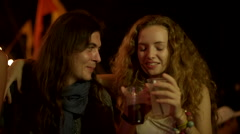 Couple talks and drinks at a party Stock Footage