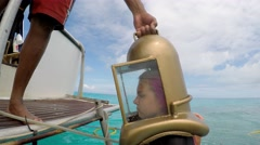 Girl comes down from boat on the Bermuda Helmet Diving tour. Bermuda - stock footage