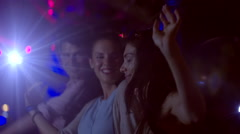 Group of friends cheer at concert - stock footage