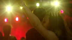 Girl dances seductively at concert Stock Footage