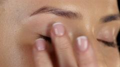 Makeup artist applies concealer on the model's. Closeup Stock Footage