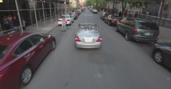 Following A Convertible Mercedes Benz On A Street In Harlem Stock Footage