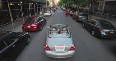 Viewing A  Stationary Then Moving Convertible Mercedes Benz In Harlem Stock Footage