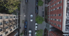 Look Down Shot Of A Convertible Mercedes Benz On A Street In Harlem Stock Footage